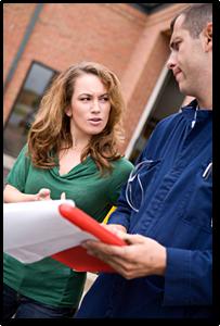 woman talking to windshield repair man